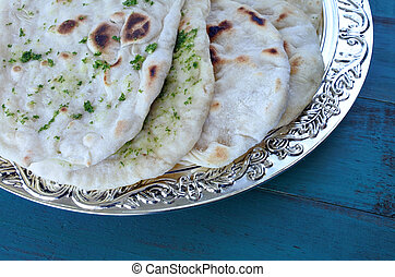 Indian Naan flatbread - Flat lay view of Indian Naan, nan or...