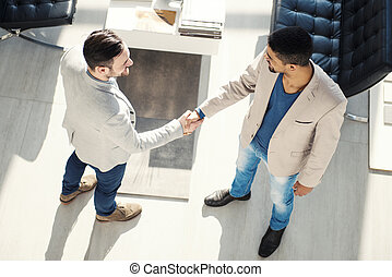 Business Agreement - Handshake between two business...