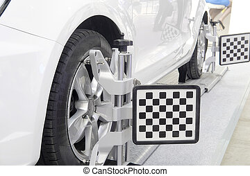 Wheel alignment equipment on a car