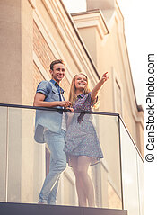 Beautiful young couple - Low angle view of beautiful young...