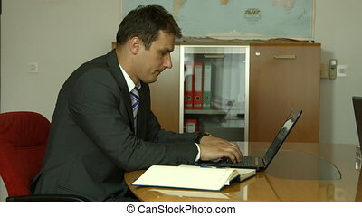 Man working in office on computer