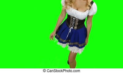 Woman in bavarian costume is in the room and touches the...