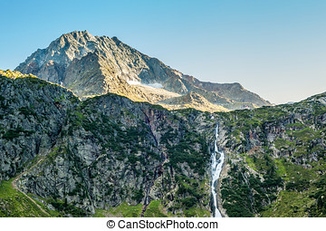 View from the Sulzenaualm, mountains,peaks and waterfall -...