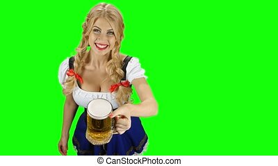 Woman in bavarian costume gives beer and winking eyes...