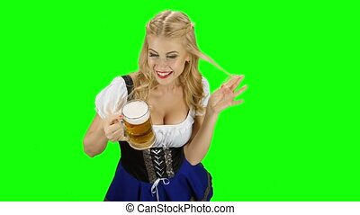 Bavarian girl in bavarian costume offers someone a beer and...