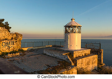 Sunset over Lighthouse in Kavala - Last rays of sun over...