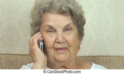 Elderly grandmother talking on the mobile phone