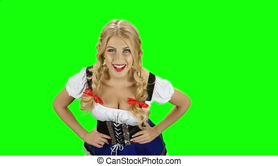 Girl in bavarian costume seductive beckoning by finger to...