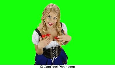 Girl in bavarian costume flirting with someone. Oktoberfest....