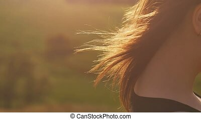 close up under the sun haired girl slow motion video -...