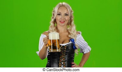 Blonde woman in traditional bavarian costume. Green screen -...
