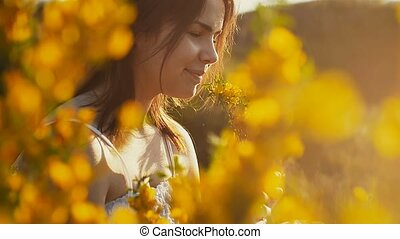 through the yellow flowers girl seen slow motion video -...