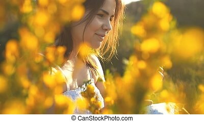 the girl laughs and sniffs flowers slow motion video - the...