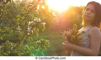 girl with a bouquet apple tree blossoms in slow motion video