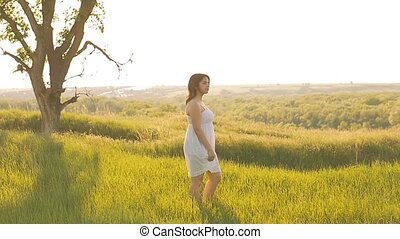 on a green meadow the girl dressed in slow motion video