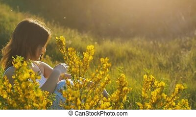 summer girl in yellow wildflowers slow motion video - summer...