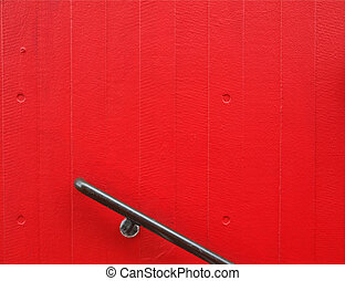 Handrail over a red painted concrete wall