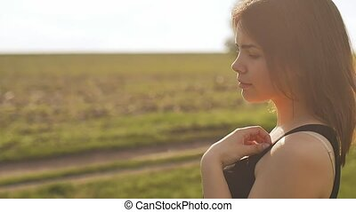 view the profile of face girl in the sun slow motion video -...