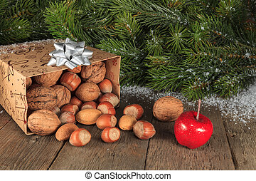 X-Mas Arrangement 2 - Fruits falling from gift box on wooden...