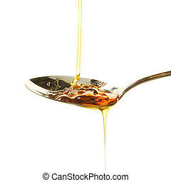Syrup in spoon - Syrup pouring into a desert spoon isolated...