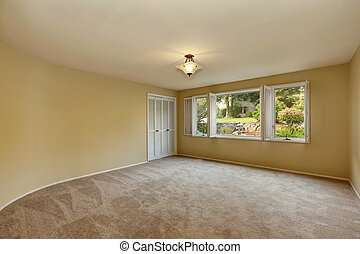 Empty room in beige and yellow colors with open window