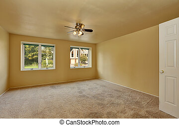 Empty room in beige and yellow colors with carpet floor