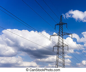 High voltage electricity pylon system on the sky background