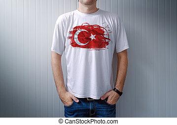 Man wearing white shirt with Turkey flag print - Man wearing...