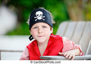 Pirate - Outdoor portrait of cute boy dressed as pirate