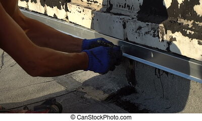 Workers repair the roof of the house - Worker repairing the...