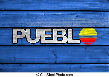 Flag of Pueblo, Colorado, USA, painted on old wood plank background