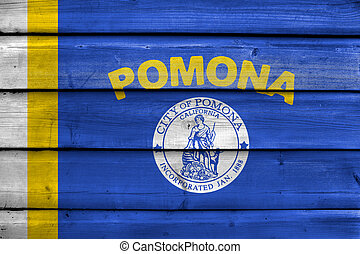 Flag of Pomona, California, USA, painted on old wood plank...