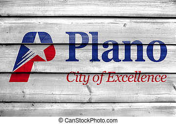 Flag of Plano, Texas, USA, painted on old wood plank background
