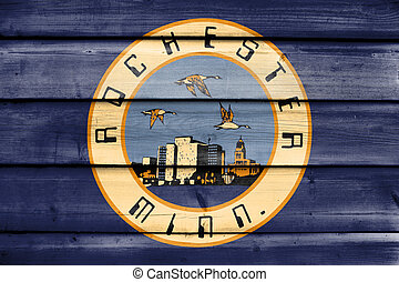 Flag of Rochester, Minnesota, USA, painted on old wood plank background