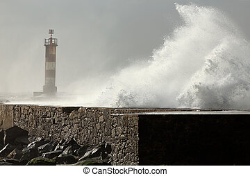 Sunny stormy sea waves over pier and beacon Ave river mouth,...