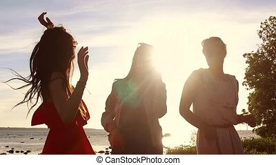 group of happy women or girls dancing on beach 40 - summer...