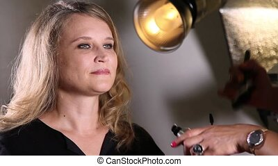 Makeup artist applies skintone - Professional makeup artist...