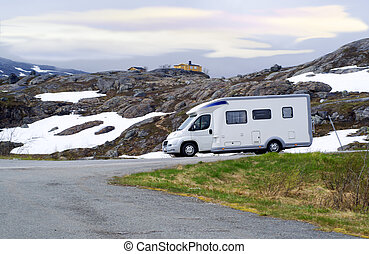 Caravan van on high-mountainous road of Norway