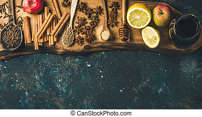 Ingredients for making mulled wine over blue painted plywood...