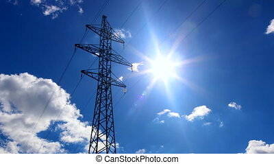 Electricity pylon - Cloud sky and sun behind the Electricity...