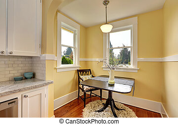 Small dining room area with yellow walls