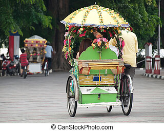 Trishaw ride - One of the numerous trishaw riding in the...