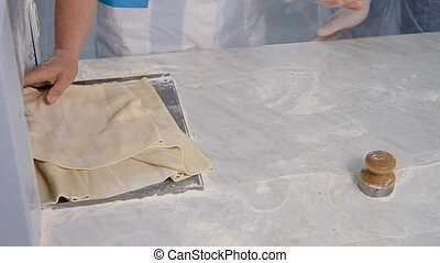 Preparation of the dough for making dumplings - A cook is...