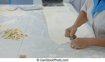 Manufacturing of a large number of dumplings in hand - A...