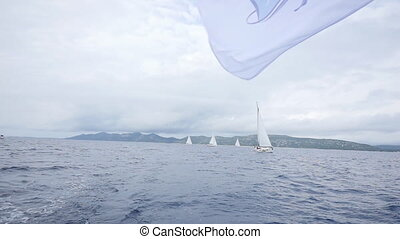 Sailing ship yachts with white sails in open Sea. - Sailing...