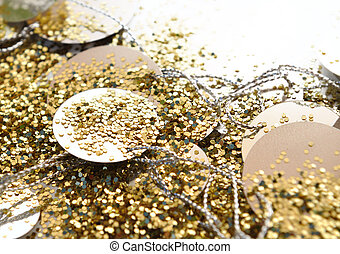 golden glitters - close on golden glitters and confettis on...