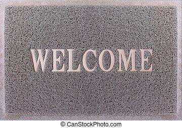 Welcome Door Mat Isolated. Friendly Grey Door Mat Closeup. Welcome Carpet. Foot Scraper Texture Background.