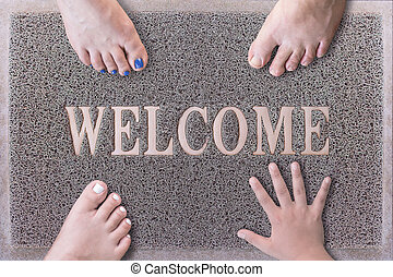 Welcome Door Mat With Three Feet and One Hand. Friendly Grey...