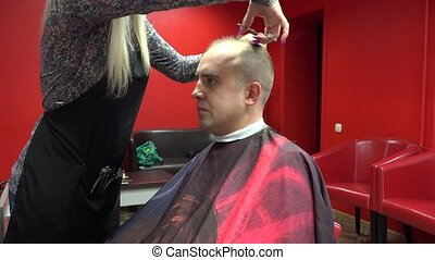 woman hairdresser cut man client in own barbershop 4K -...
