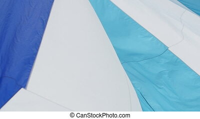 Multicolored Sail blows in wind on a boat - Multicolored...